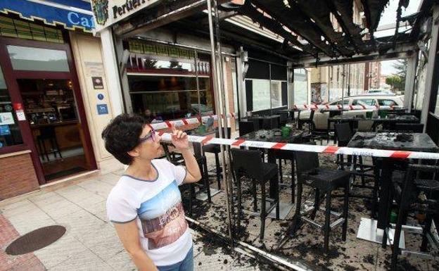 Detenido un menor por el incendio de la terraza de un bar for Terrazas oviedo