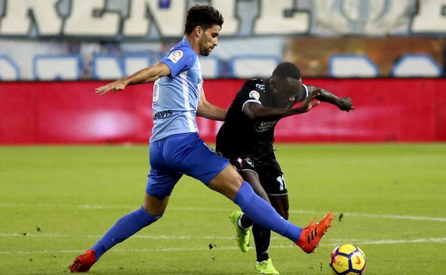 Adrián y Recio dan la primera victoria al Málaga y oxígeno a Míchel