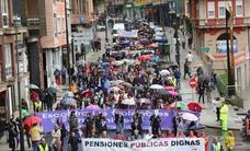 La tormenta ahoga la manifestación por las pensiones en Avilés