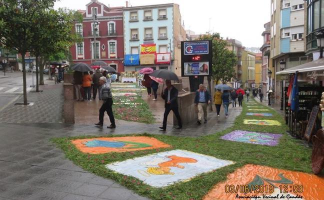 La lluvia obliga a suspender la procesión del Corpus de Candás