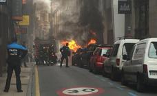 La Policía trata de identificar al incendiario de contenedores en Gijón
