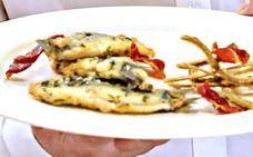 Bocartes rellenos de anchoas, rebozo de vino blanco y fritura de sus raspas