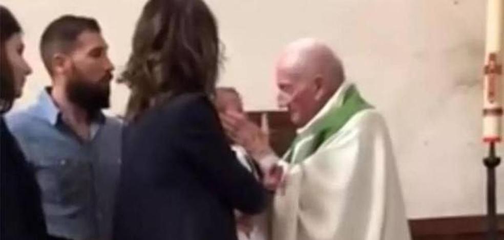 Indignación ante las imágenes de un cura abofeteando a un bebé en su bautizo