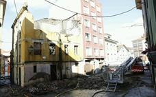 Las familias afectadas por el incendio de Cimavilla podrán volver a sus casas a lo largo del día