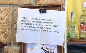 El original cartel en un local de Ribadesella para que los clientes no dediquen un tiempo abusivo a la lectura del periódico