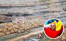Fallece un parapentista tras engancharse con un árbol y caer en un acantilado de playa España, en Villaviciosa