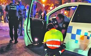 Un coche del Rally atropella a un policía local en Oviedo