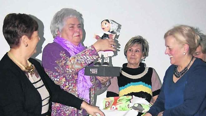 Premio a dos décadas volcadas con la tradición